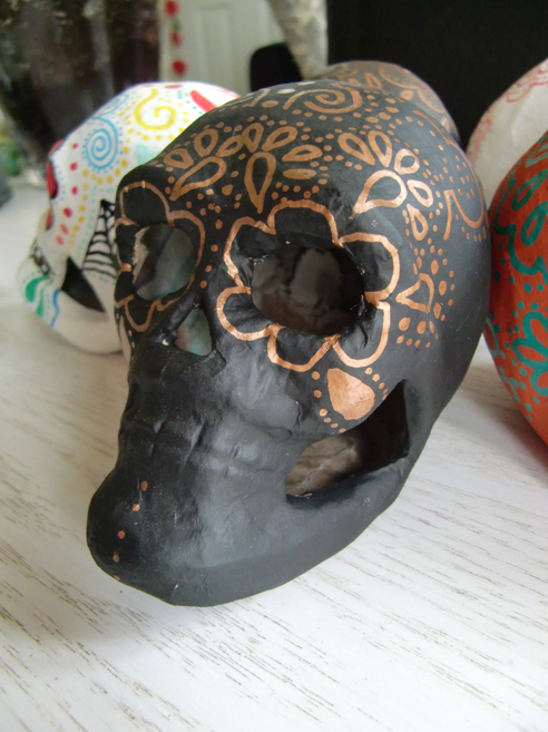 black sugar skull with copper design