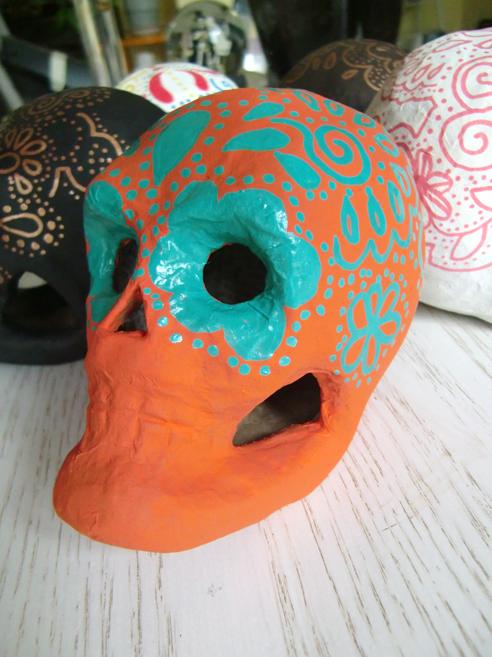 orange sugar skull with teal design