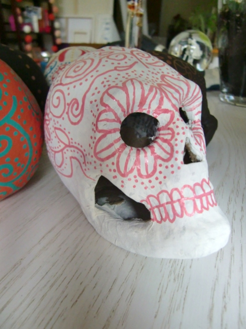 white sugar skull with pink design