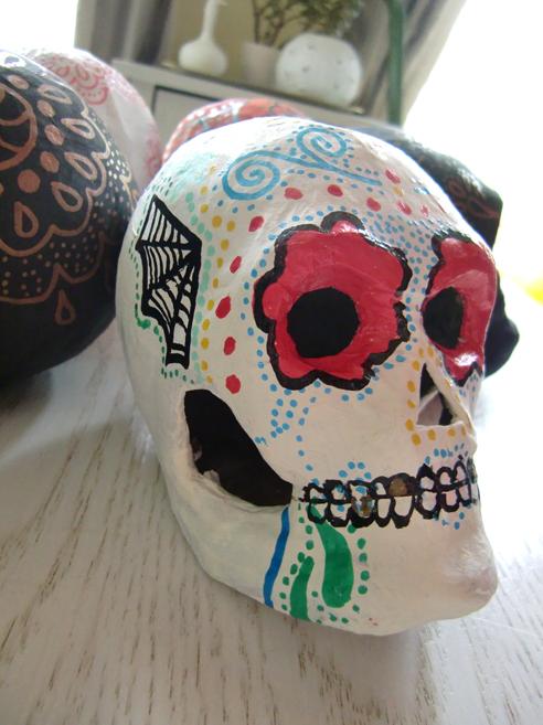 white sugar skull with multi-coloured design