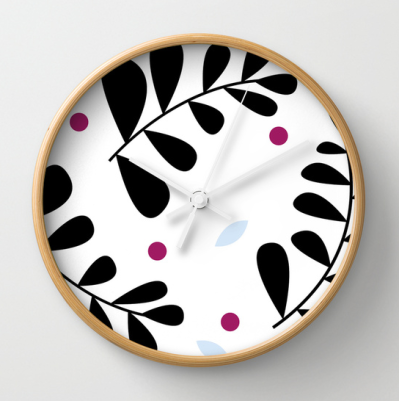 simple fern clock black berry coloured light wood frame