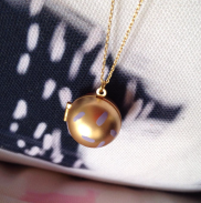 Gold painted locket by Kodiak Milly on etsy