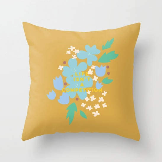 life isnt a competition mustard yellow flower typography print pillow by Kristen Lourie on Society6
