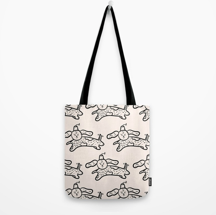 emotionless-dog-jumping-wearing-a-fez-by-kodiak-milly-tote-bag