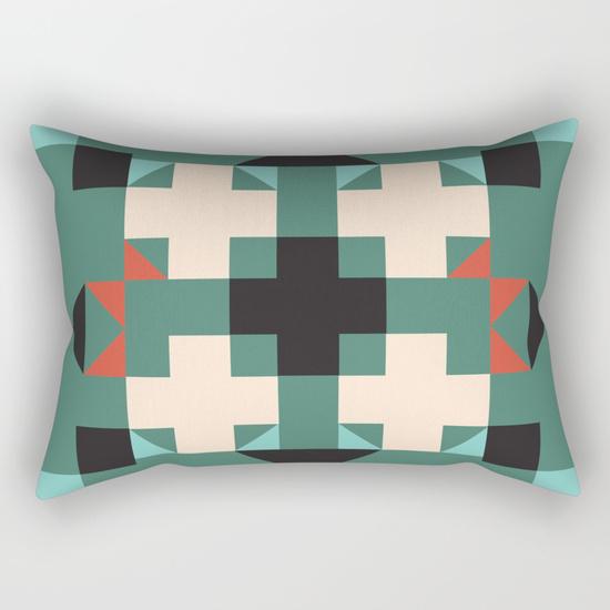 geometric-quilt-like-pattern-deep-green-rust-ivory-black-rectangular-pillows